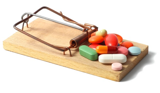 Mousetrap with pills on it