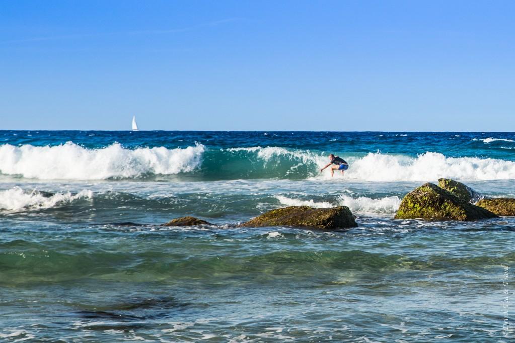 A surfer riding a wave at Coolangatta Beach, Gold Coast, Australia