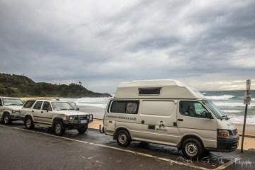 Campervans line Flynn's Beach in Port Macquarie, NSW