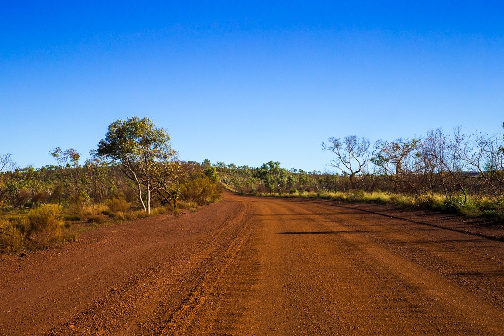 Unsealed red dirt road leading up to Karijini National Park. Western Australia