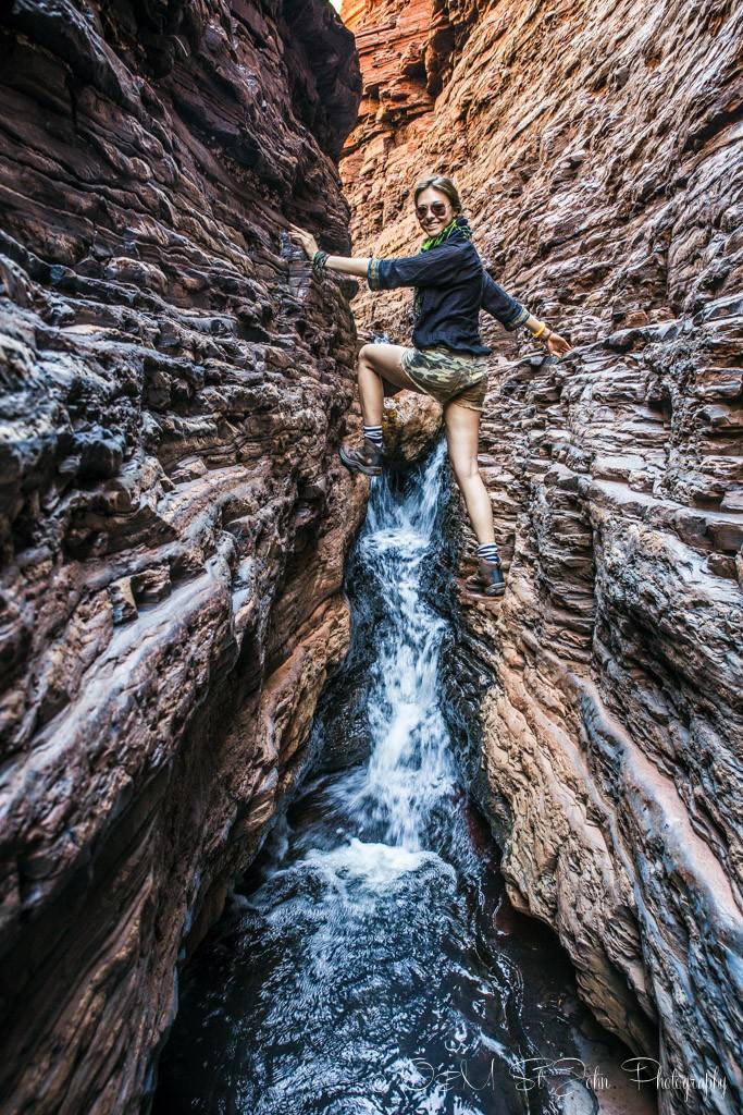 Traversing the Hancock Gorge's narrow passage. Karijini National Park. Western Australia