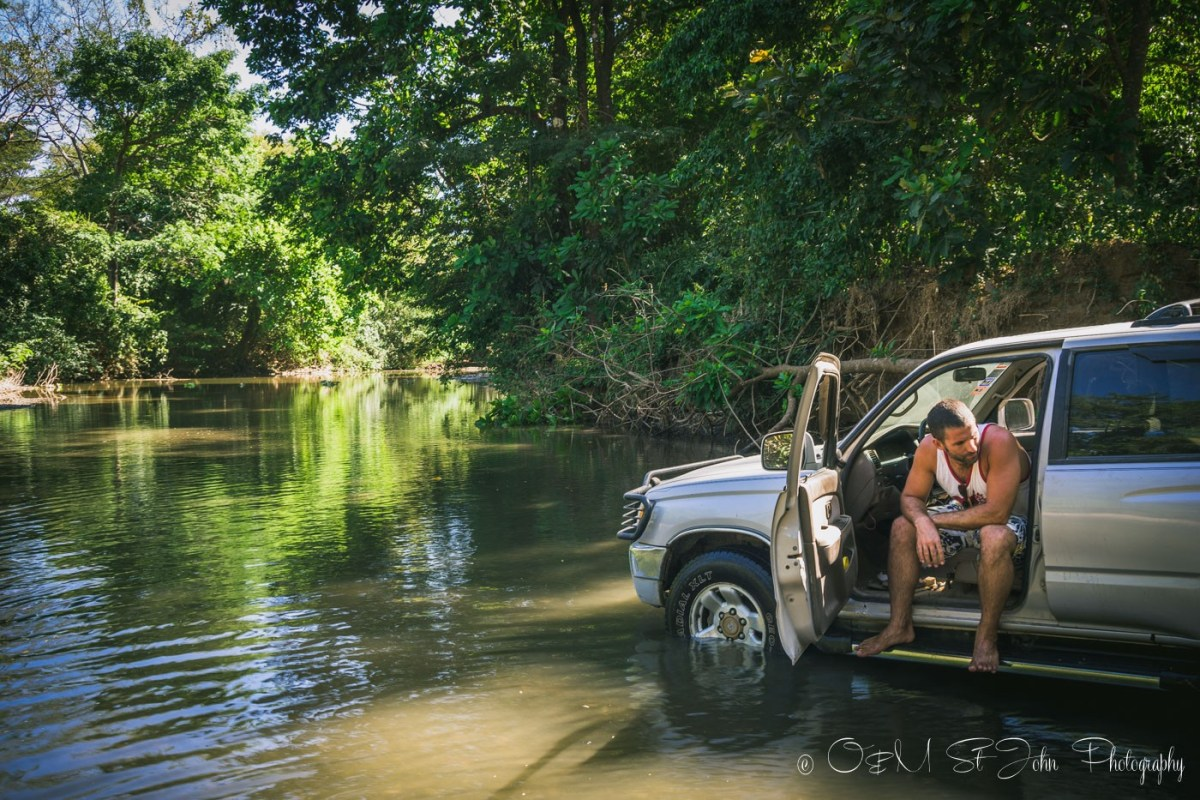 Costa Rica travel tips: Max at a river crossing in Costa Rica