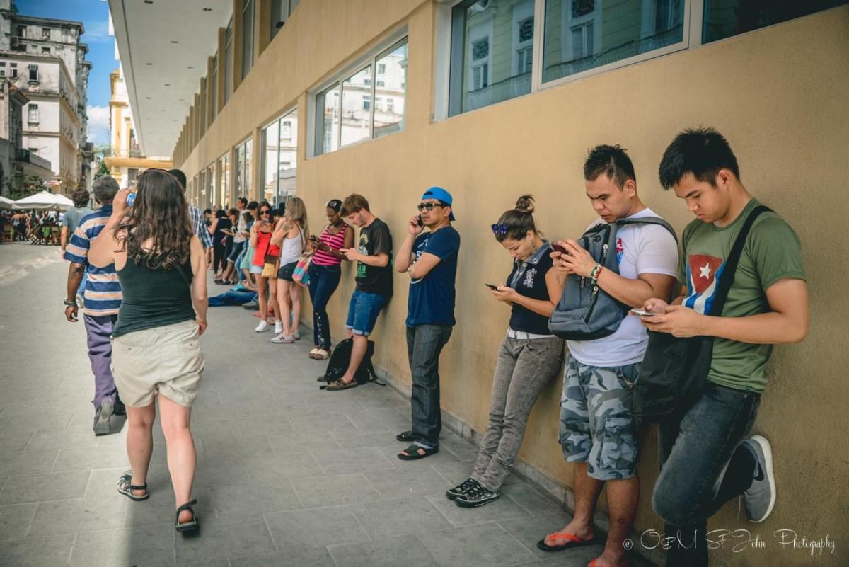 Internet in Cuba: Locals and visitors accessing the internet in Havana, Cuba