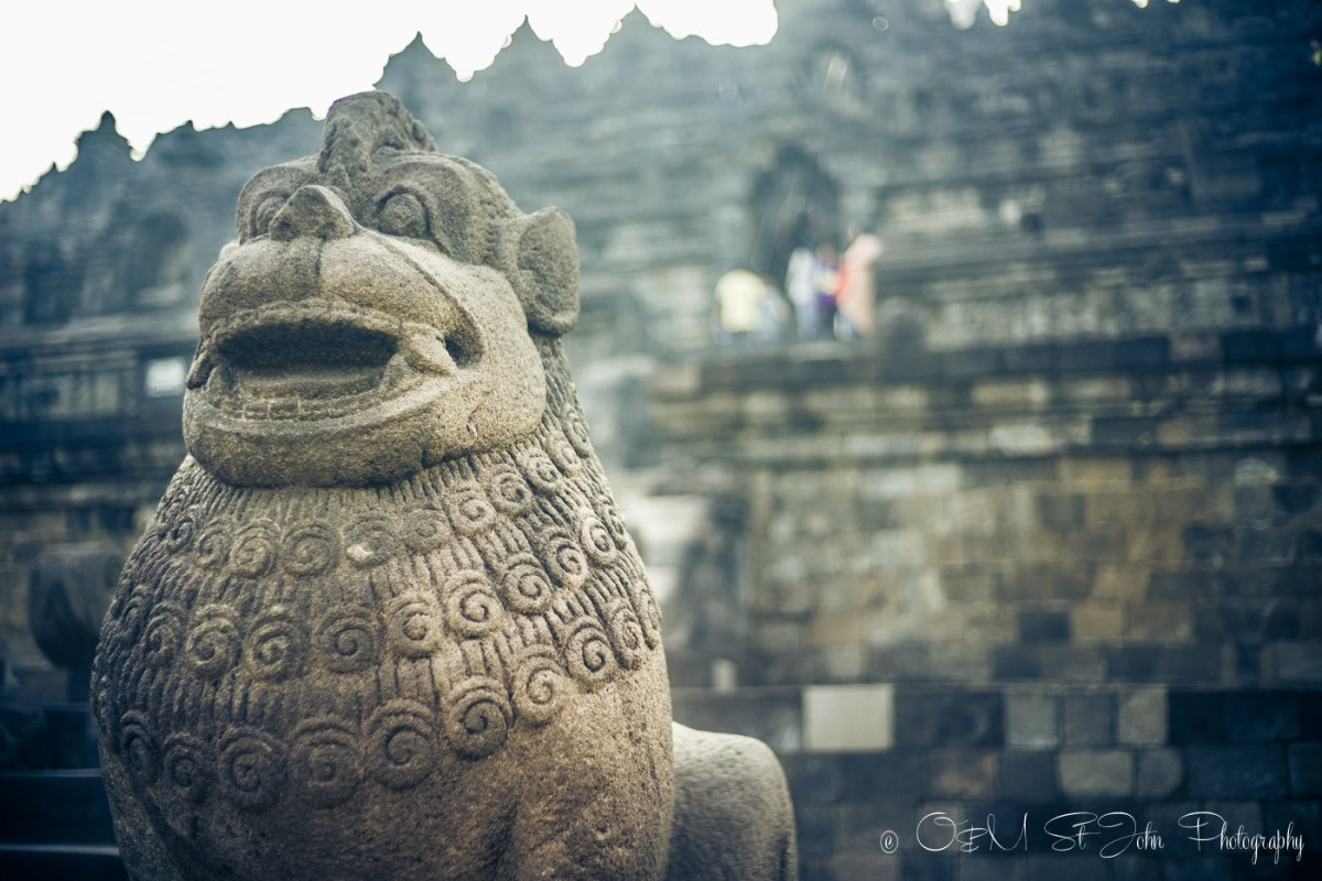 Statues at the entrance to Borobudur. Indonesia