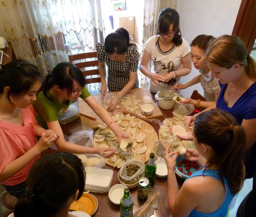 Learning to make dumplings with our Chinese colleagues. Photo courtesy of Goats on the Road