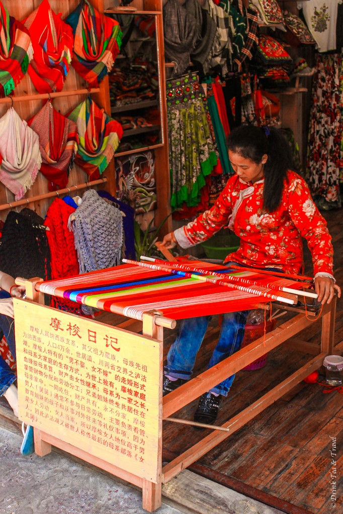 Local woman weaving inside her shop in Lijiang, China