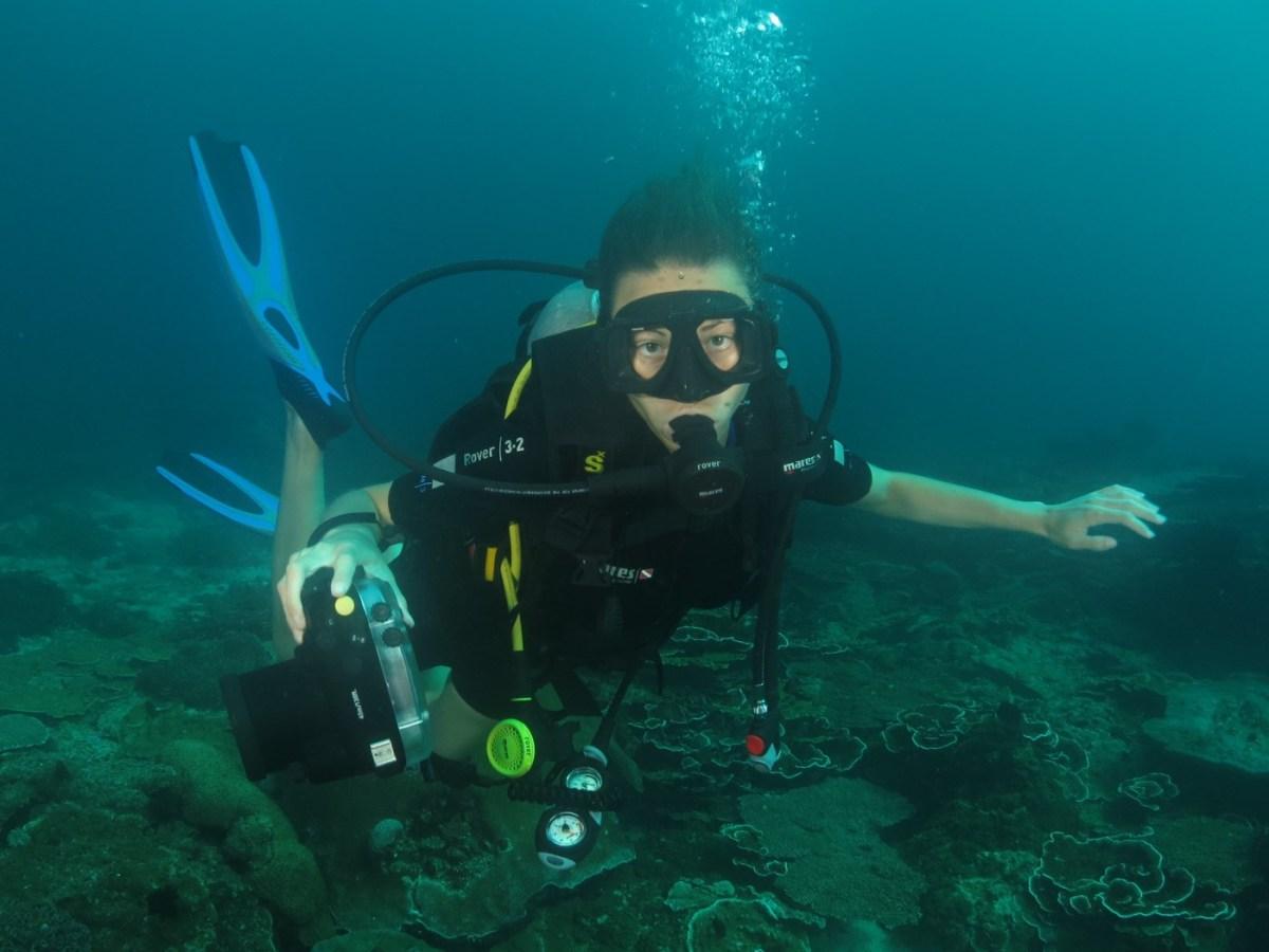 Oksana diving in Manana, Sabah, Malaysia.