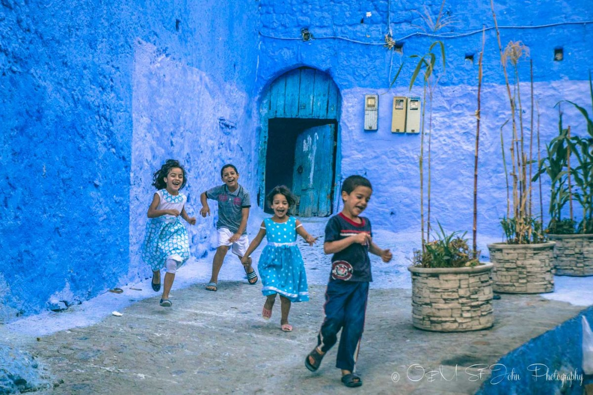Kids running in Chefchaouen, Morocco