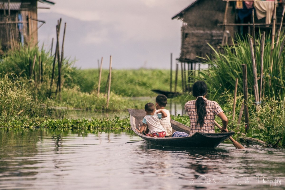 Family sails to their home in Inle Lake. Myanmar