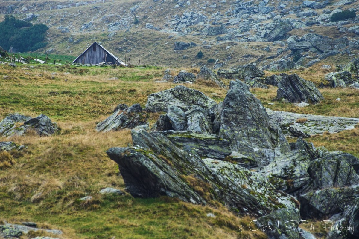 Wooden hut among the rugged surroundings along the Transfagarasan. Romania