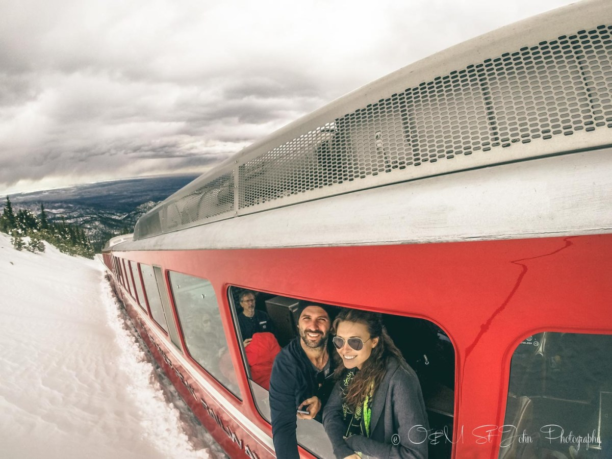Max & Oksana peaking out of Cog Railway en route to the top of Pikes Peak. Rocky Mountains. Colorado. USA Road trip