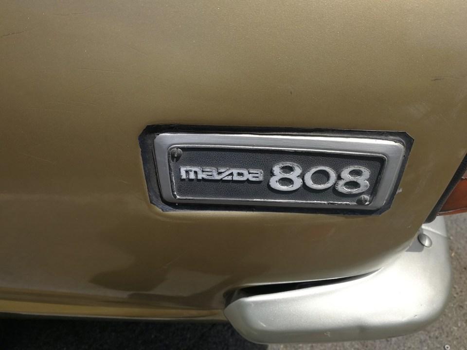 Mazda 808 badge