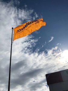 DriveNation Flag Waving Outside Calgary Dealership