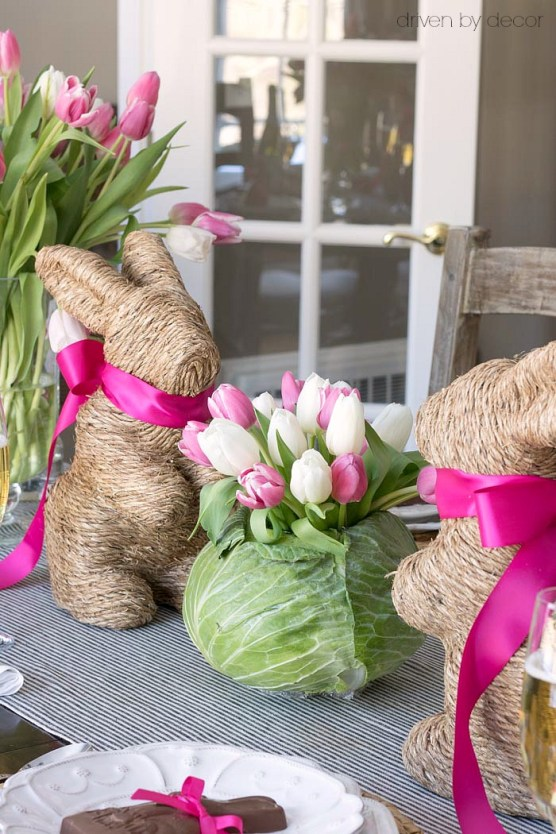 Darling idea for an Easter table centerpiece! Hollow out a cabbage to fit a small glass vase and fill with tulips!