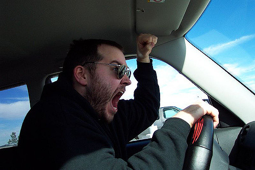 Driver with angry hand gesture