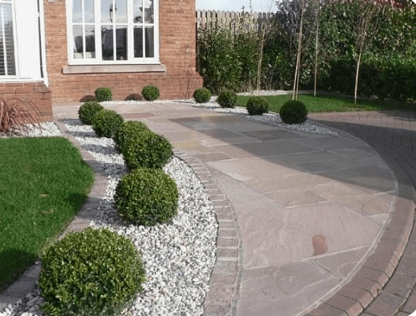 driveway landscaping ideas block paving driveway with topiary bushes and gravel landscaping