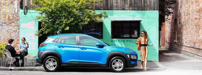 blue hyundai kona electric car (EV) parked on the street
