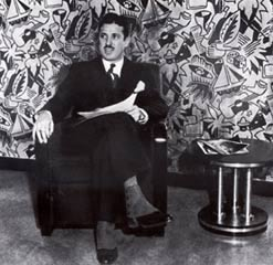 1932, Donald Deskey in the second mezzanine men's lounge. Radio City Music Hall.