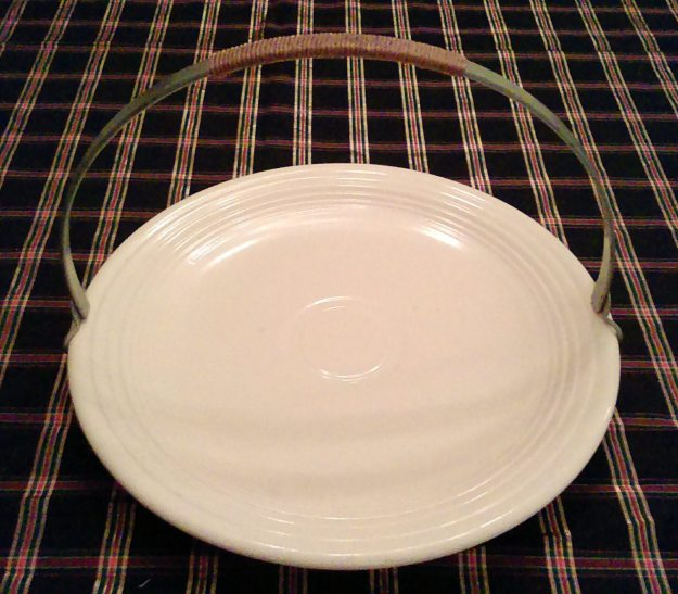 The chop plate with metal handle.