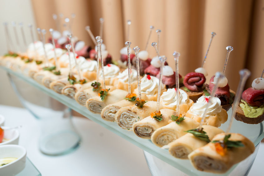Сatering banquet table with different snacks and desserts
