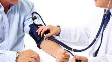 mens health risks blood pressure cuff doctor