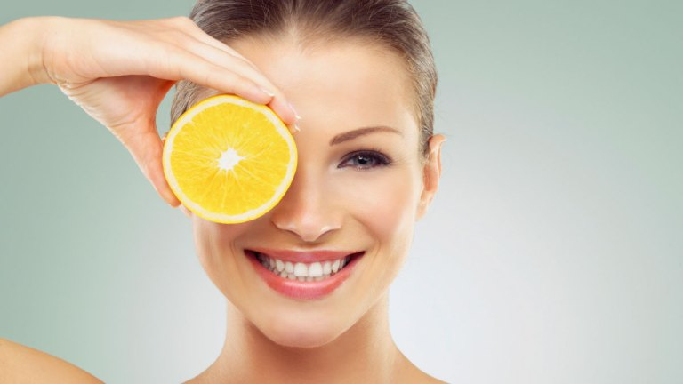 healthy skin food nutrients woman with citrus