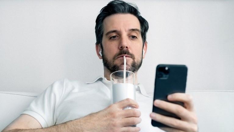 man drinking milk