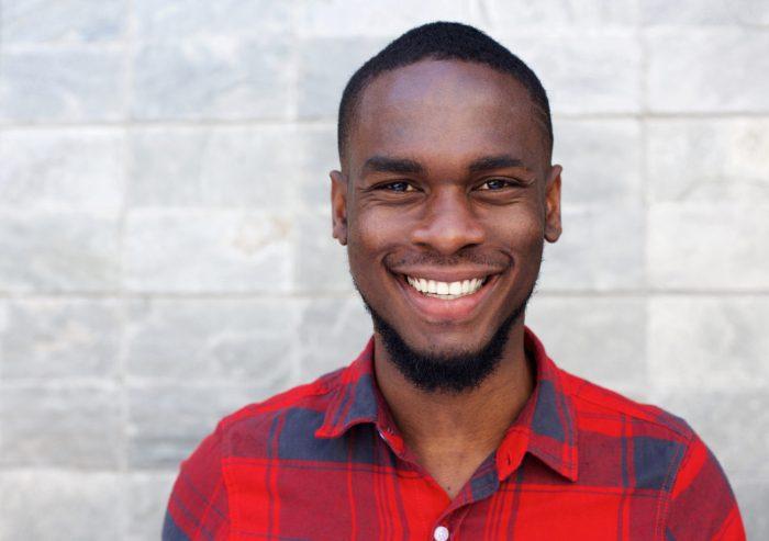 Happy young man smiling microthin veneers shippensburg pa