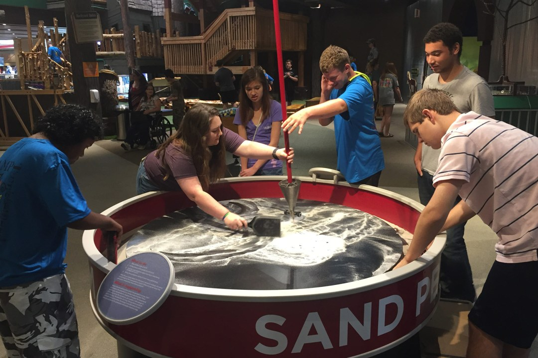 Camp Tumbleweed participants at the sand pendulum at Science Museum Oklahoma.