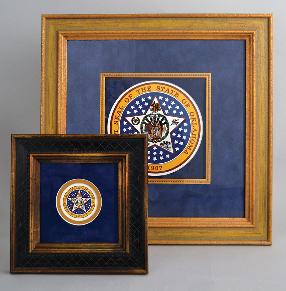 Two framed Oklahoma State seals.