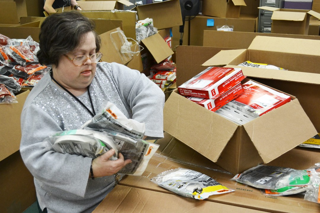 An individual sorts several products as part of a subcontracting project.