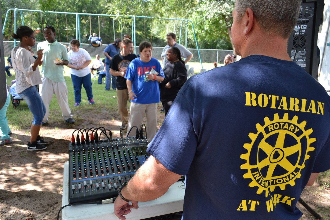 A West OKC Rotarian operates the DJ stand during a Fun Fest event.