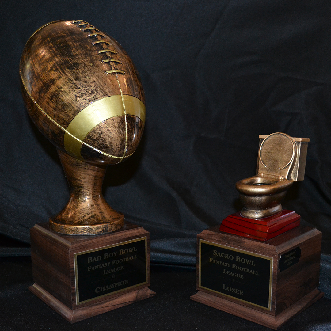 Two fantasy football trophies: first and last place.