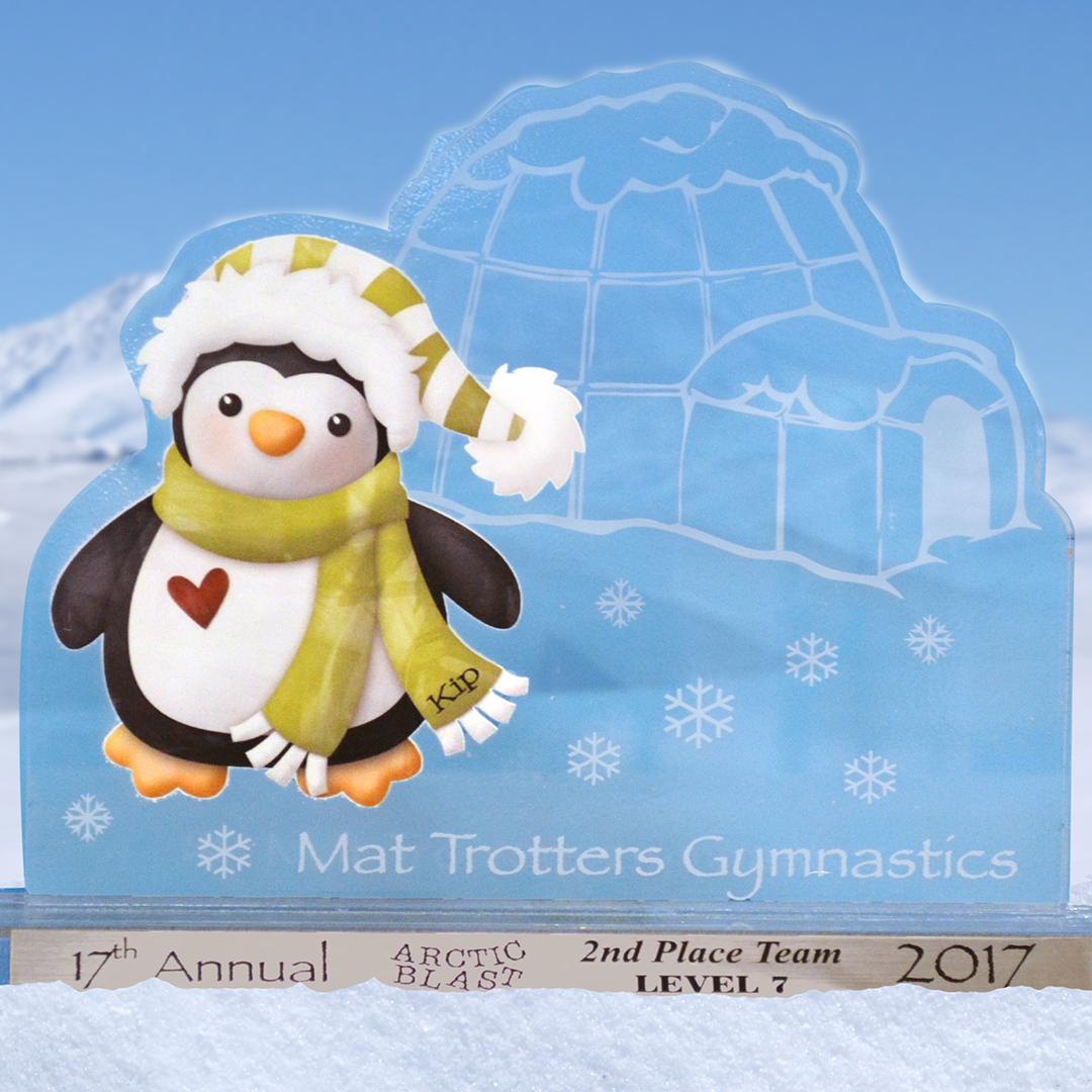 Custom acrylic award featuring an igloo and a penguin.