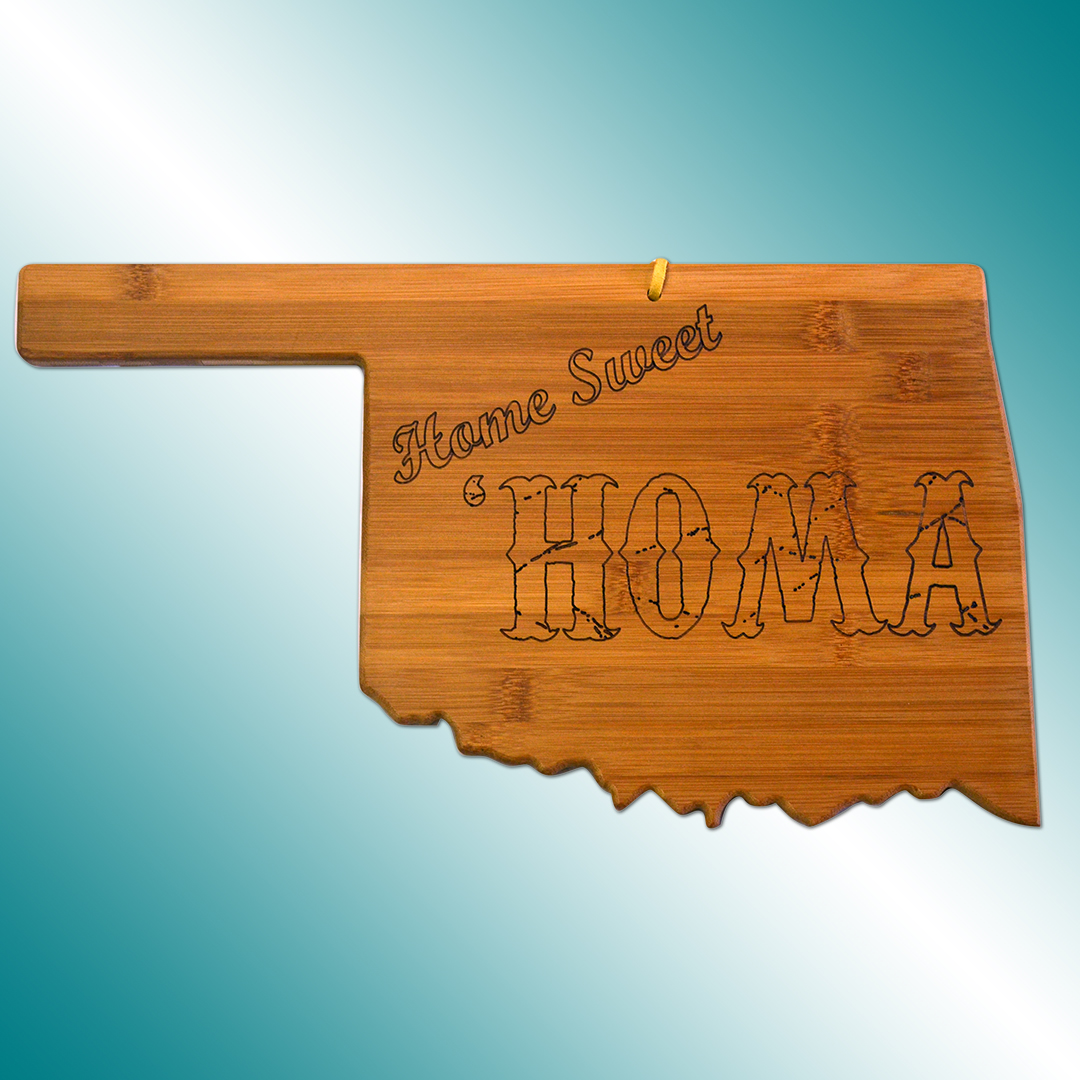 "Oklahoma-shaped wooden cutting board with ""Home Sweet 'Homa"" engraved on it."
