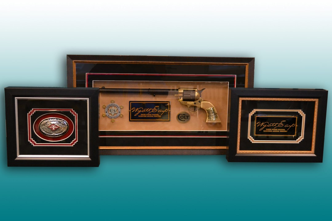 Three separate framed Wyatt Earp items.