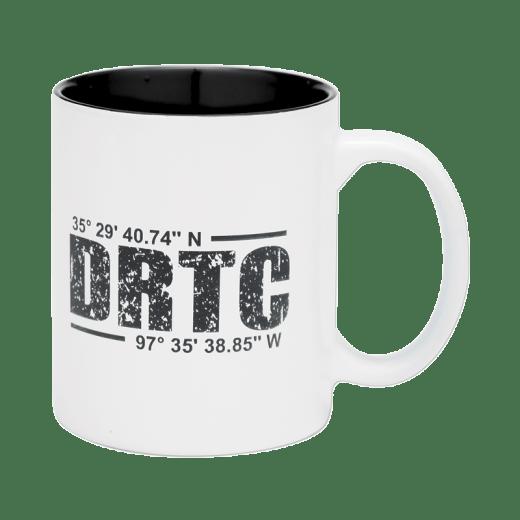 White coffee mug with DRTC's latitude & longitude coordinates