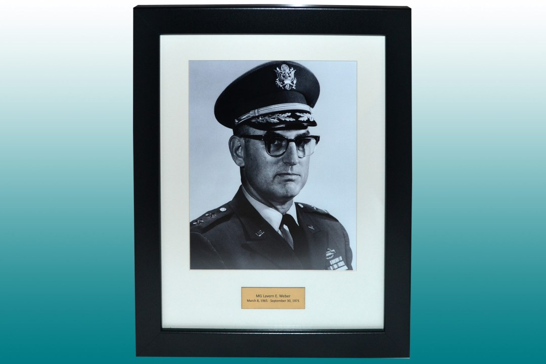 Framed headshot of MG Weber.