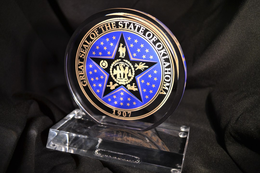 Circle acrylic with the OK State Seal.