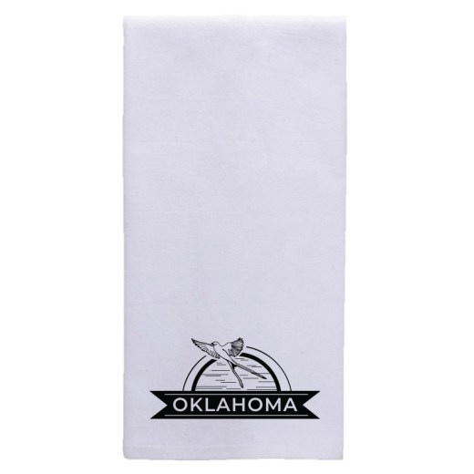 "Folded white tea towel with an imprint at the bottom showing a scissor tail flycatcher flying in front of a half circle. Banner below reads ""Oklahoma."""