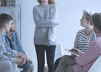 family giving intervention to woman