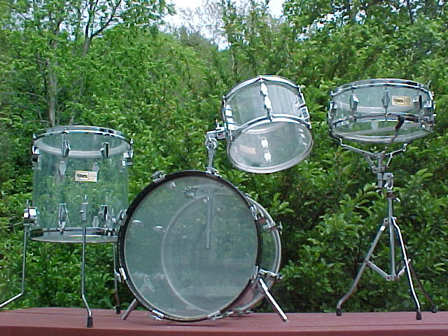 Bobby s Personal Collection Here we have a players set of jazz sized clear FiBES  not common Click Here  Whoever had this set modified it with a Pearl tom arm