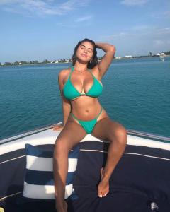 busty bikini babe busting out on a boat.jpg
