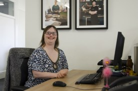 Kate Powell, editor of Down2Earth Magazine sat at her desk