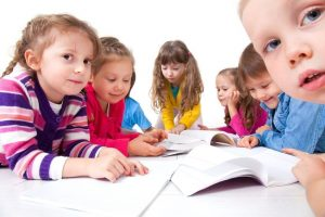 16035996 - group of children enjoying reading together