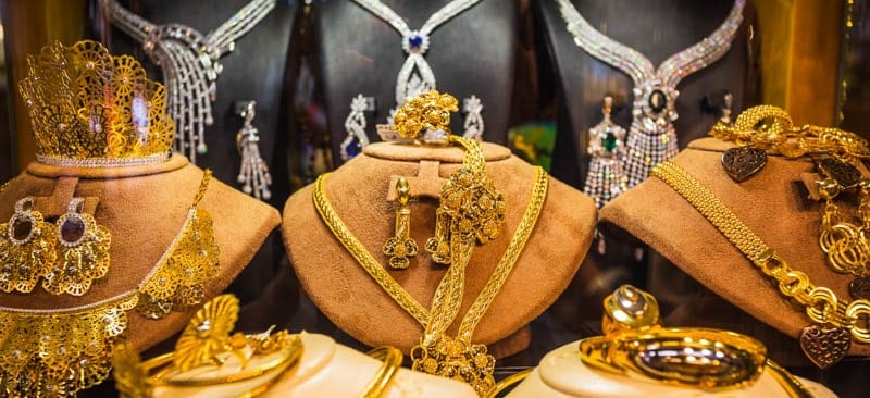 Gold chains, necklaces, bangles, and other items of jewellery on display in Gold Souk in Dubai.