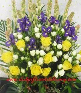 corporate flowers Dubai in yellow white and blue