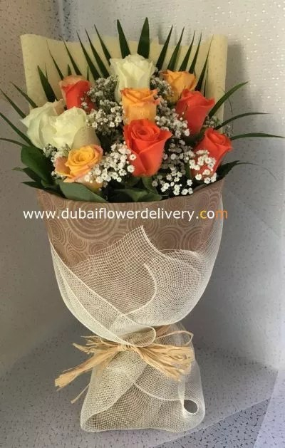 Mix color bouquet of yellow white and orange roses
