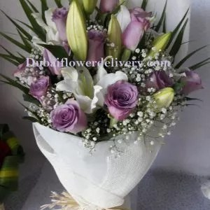 purple white bouquet with roses and lilies