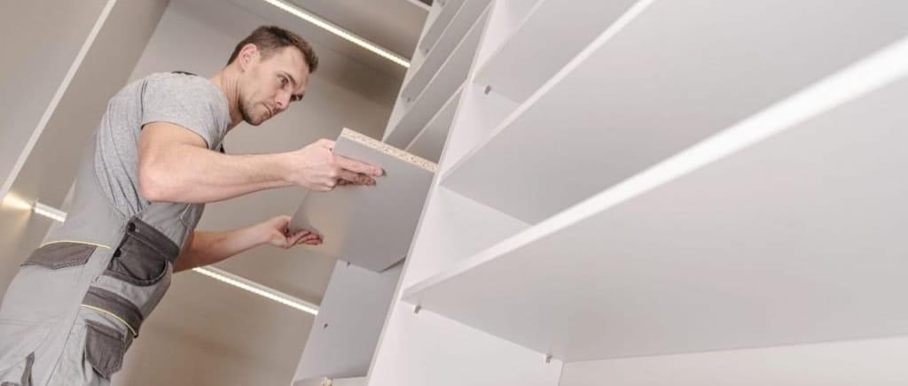 handyman assembling shelves
